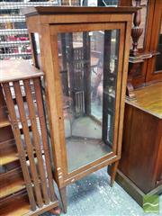 Sale 8485 - Lot 1012 - Biedermeier Style & Possibly Period Walnut Corner Display Cabinet, with glass panel door, marquetry to fascia & on tapering legs (cr...