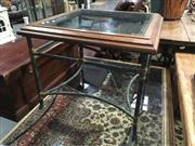 Sale 8795 - Lot 1015 - Glass Top Occasional table with Wrought Iron Base