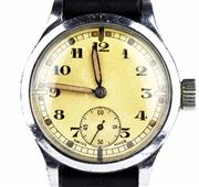Sale 8402W - Lot 18 - A WWII STAINLESS STEEL MILITARY SERVICE WRISTWATCH; with Arabic numerals, subsidiary seconds on a 15 jewell Swiss movement, case mar...