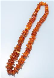 Sale 9037F - Lot 80 - A LARGE GRADUATED AMBER BEAD NECKLACE; 20-32mm freeform amber beads, length 80cm.