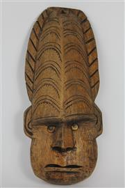 Sale 8520T - Lot 29 - Decorative wall mask with small operculum eyes. Protruding angle nose. Carved head hanging wire,