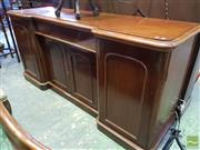 Sale 8539 - Lot 1053 - Victorian Mahogany Break Front Sideboard, with a long drawer, two small and two larger arch top doors, enclosing a cellarette drawer...