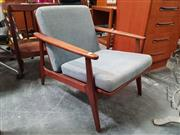 Sale 8839 - Lot 1068 - Vintage Teak Lounge Chair with Rattan Back
