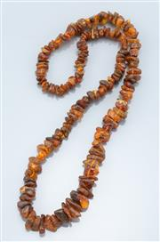 Sale 9095 - Lot 353 - A GRADUATED AMBER BEAD NECKLACE; 8 - 20mm freeform amber beads, length 70cm.