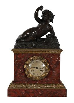 Sale 9245J - Lot 51 - A French 19th century rouge marble salon clock, with ormolu mounts with central bronze figure of the reclining child with grapes, H...
