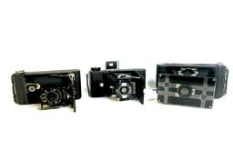 Sale 9142A - Lot 5042 - Group of (3) Early 120/2220 Film Cameras, working condition: (left to right) KODEX Eastman KODAK Co, Rochester N.Y USA (w/original l...