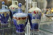 Sale 8340 - Lot 25 - Royal Doulton Grants Liqueur Glazed Decanters (1 Missing Stopper)