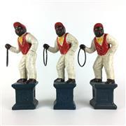 Sale 8795K - Lot 291 - Three painted cast iron figures