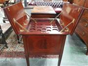 Sale 8939 - Lot 1039 - Early 20th Century Inlaid Mahogany Drinks Cabinet, in the Georgian manner, the hinged top revealing mechanical trays fitted for glas...