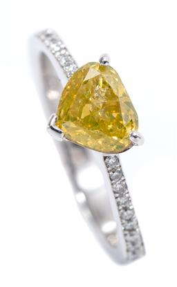 Sale 9199J - Lot 52 - AN 18CT WHITE GOLD FANCY YELLOW DIAMOND RING; featuring a 1.16ct P2 wide pear cut fancy yellow diamond (surface reaching fracture an...