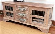 Sale 8990H - Lot 28 - An Indonesian timber entertainment cabinet featuring two grill effect doors flanking three central drawers with oversize metal handl...
