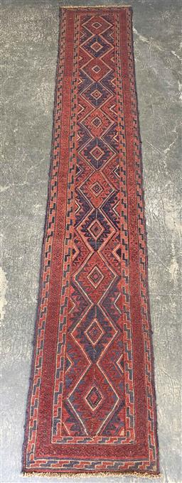 Sale 9112 - Lot 1070 - Hand knotted pure wool Persian Baluchi runner in red tones (380 x 65cm)