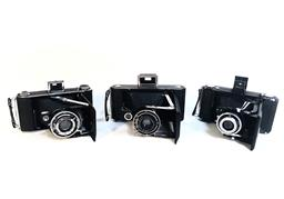 Sale 9142A - Lot 5043 - Group of (3) Early 120/2220 Film Cameras, working condition: (left to right) ENSIGN Selfix 420 Epsilon, made in England (w/original...