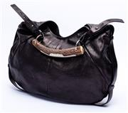 Sale 8921 - Lot 5 - AN YVES SAINT LAURENT MOMBASA LEATHER HORN HANDLE BAG; hobo style black leather with silver tone hardware and adjustable horn handle...
