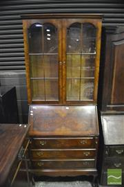 Sale 8345 - Lot 1060 - Georgian Style Burr Walnut Bureau Bookcase, with two astragal doors & three drawers on cabriole legs
