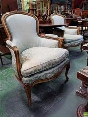 Sale 8559 - Lot 1076 - Pair of Louis XVI Style Carved Walnut Armchairs, upholstered in a mint green possibly silk fabric & on cabriole legs