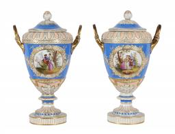 Sale 9245J - Lot 71 - A pair of 19th century Royal Berlin two handled lidded urns, with hand painted central panels of the courting couple and gilt highli...
