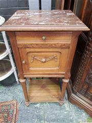 Sale 8634 - Lot 1088 - Early 20th Century French Walnut Bedside Cabinet, with brown marble top, a drawer, carved panel door, turned legs & shelf