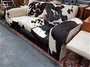 Sale 8688 - Lot 1016 - Cow Hide Upholstered Three-Seater Sofa