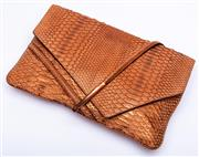Sale 8921 - Lot 39 - A CALVIN KLEIN SNAKESKIN CLUTCH; faun colour with gilt highlights and copper tone clasp, with mustard leather and grey suede interio...