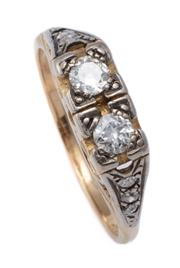 Sale 9012 - Lot 366 - A VINTAGE 15CT GOLD DIAMOND RING; centring 2 Old European cut diamonds totalling approx. 0.34ct on scroll carved gallery to shoulder...