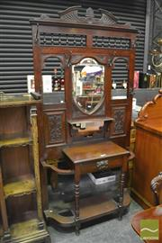 Sale 8345 - Lot 1029 - Late Victorian Carved Walnut Hallstand, with turned gallery, shield shaped mirror & a drawer