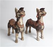 Sale 8770 - Lot 64 - A pair of decorative polychrome painted mythical animals, Indonesian circa 1920 or earlier. Provenance: From the Collection of Joy W...
