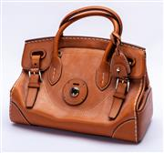 Sale 8921 - Lot 29 - A RALPH LAUREN LEATHER RICCI HANDBAG; in tan leather with white stitching, silver tone hardware and 2 keys, plus detachable shoulder...