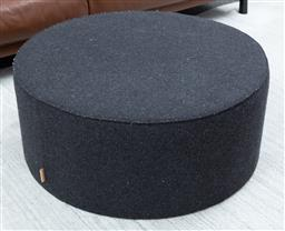 Sale 9150H - Lot 60 - A Bloomingville fabric upholstered black ottoman/ coffee table, Diameter 90cm x Height 38cm