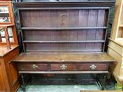 Sale 8485 - Lot 1078 - Possibly Georgian Oak Dresser, with open shelves, three drawers & turned legs (alterations)