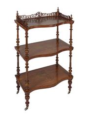 Sale 8379A - Lot 84 - A Victorian walnut whatnot with pierced fretwork and fruitwood inlays, having turned columns and standing upon brass castors with ce...