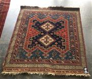 Sale 8868 - Lot 1126 - Semi-Antique Caucasian Wool Carpet, the field with triple crest & all in typical red/ blue/ black palette (145 x 128cm)