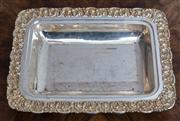 Sale 8650A - Lot 80 - An Indian silver rectangular dish with chased floral border, Length 29cm.