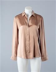 Sale 8782A - Lot 163 - A Gucci silk satin blend blouse in bronze, size 40