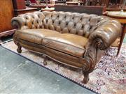 Sale 8868 - Lot 1079 - Victorian Style Brown Leather 2-Seater Chesterfield Style Lounge, with loose cushions, carved fascia & cabriole legs