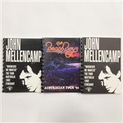 Sale 8893M - Lot 83 - Two John Mellencamp Whenever We Wanted 1992 Australian Tour Itinerary together with a Beach Boys 1992 Australian Tour Itinerary