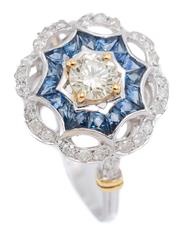 Sale 9080J - Lot 53 - AN 18CT WHITE GOLD SAPPHIRE AND DIAMOND RING; target mount centring an approx. 0.28ct light yellow round brilliant cut diamond, P1,...