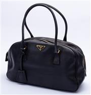 Sale 8921 - Lot 42 - A PRADA BLACK SAFIANO LEATHER BOULETTO BAG;  with gold tone hardware, padlock and 2 keys 31 x 22 x 14cm.