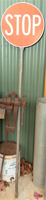 Sale 8984W - Lot 575 - A large cast iron bench mount vice. Height 88cm together with a STOP sign