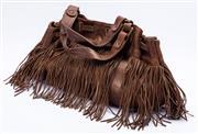 Sale 8921 - Lot 47 - A GERARD DAREL FRINGED BROWN LEATHER HANDBAG; lamb skin with cotton interior material, 39 x 26 x 10cm.