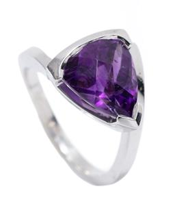 Sale 9199J - Lot 54 - A SILVER AMETHYST RING; collet set with a chequerboard trilliant cut deep purple amethyst of 11 x 8.5 x 7.4mm, size N, width 15.5mm,...