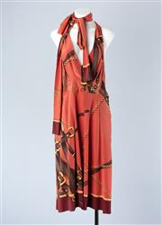 Sale 8782A - Lot 167 - A Gucci printed silk/ satin halterneck dress with pleat detailing and built in neck sash, size 42