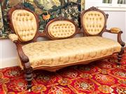 Sale 8804A - Lot 125 - A Victorian carved walnut triple cameo back settee with buttoned upholstery Width 176cm
