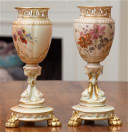 Sale 9190H - Lot 52 - A pair of antique Royal Worcester vases C: 1894, the pierced averted mask head necks on the blush ivory ovoid shaped bowls painted w...