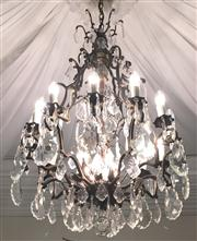 Sale 8516A - Lot 29 - A bronzed 16 light Louis XV style chandelier, with hand cut faceted pendants, rewired to Australian safety standards. 100cm high x...