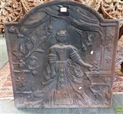 Sale 8598 - Lot 1083 - Elizabethan Style Cast Iron Fire Back, of a woman in crinoline dress standing in a curtained door way
