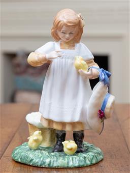 Sale 9190H - Lot 55 - A Royal Doulton figurine, Feeding Time HN 3373