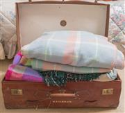 Sale 8375A - Lot 109 - A suitcase full of blankets including onkaparingas