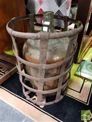 Sale 8480 - Lot 1042 - Glass Bottle in Metal Basket