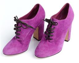 Sale 9091F - Lot 28 - A PAIR OF DOLCE AND GABBANA VERY RARE RUNWAY BOOTS, with block heels in purple suede and brown laces size 39.